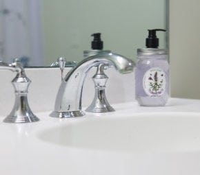 A closeup of a faucet and soap in a model bathroom at one of our assisted living facilities.