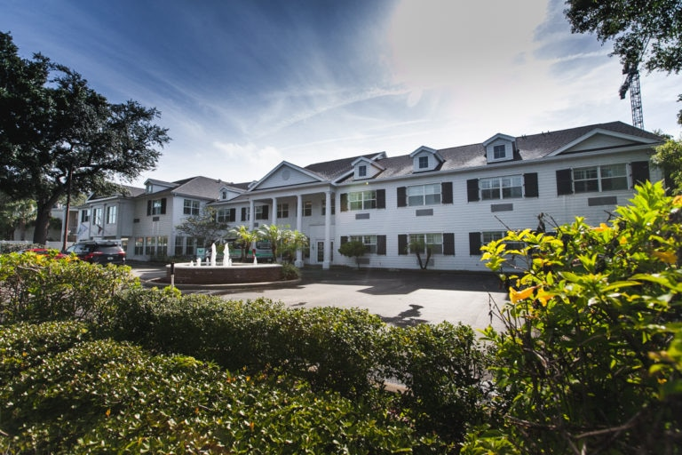 Our manor-style South Tampa assisted living facility from the front on a sunny day.