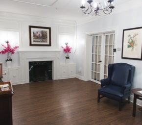 A sitting and refreshment area including fireplace at our Palma Ceia memory care facility.
