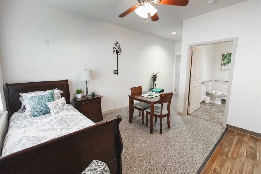 Model bedroom with speckled brown and white carpeting,