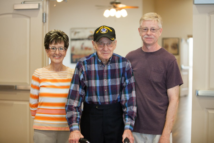 three assisted living residents smiling