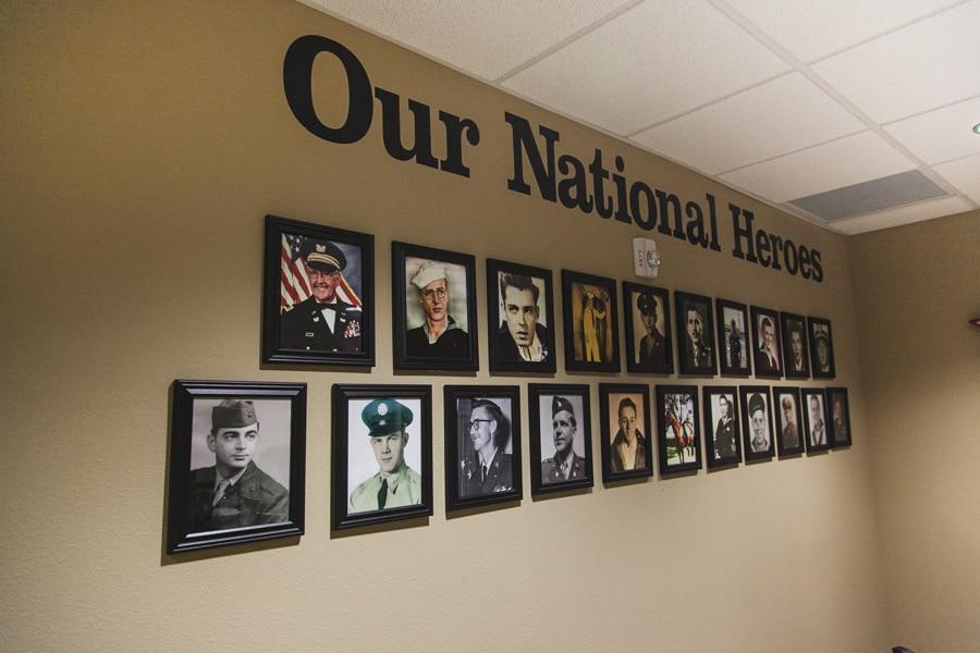 Wall of residents at The Lodges of Idlewild ALF who served in the United States Armed Forces.