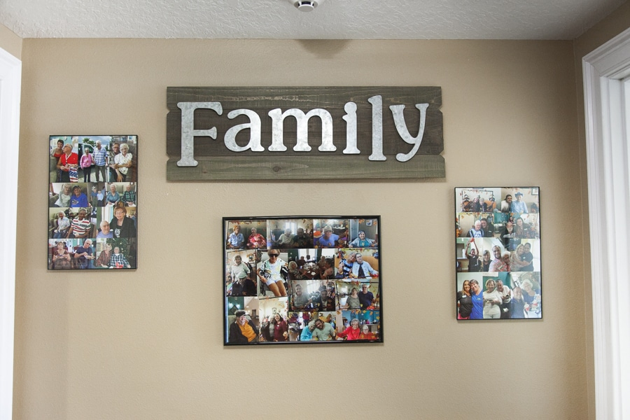 """A brown wall with mounted wooden board reading """"Family"""" in metal letters, with three collages of residents."""