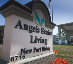 Entrance sign to our New Port Richey assisted living facility including license number and address.