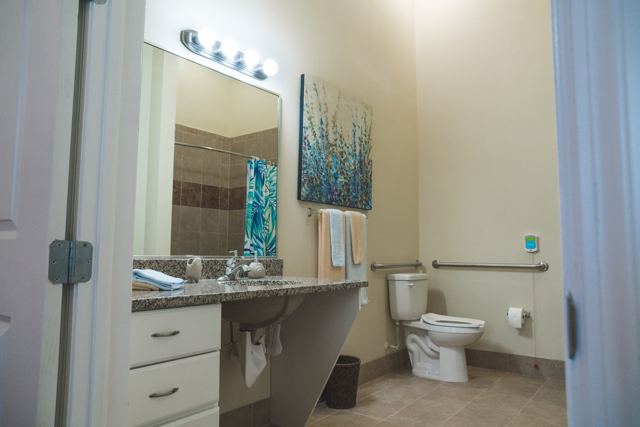This model bathroom offers a look into our community's beach decor, granite countertops, and more to help our residents feel at home.