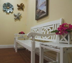 This bench at our Sarasota assisted living community showcases some of our beachy decoration.