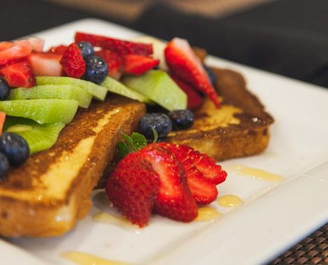Close-up of fruit and French toast on a plate at one of our assisted living facilities.