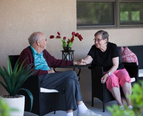 assisted living facility couple holding hands