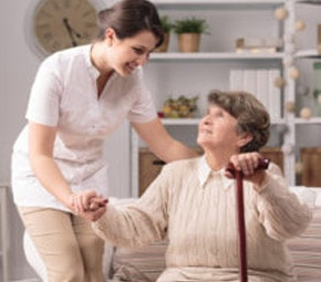 nurse helping old lady stand up